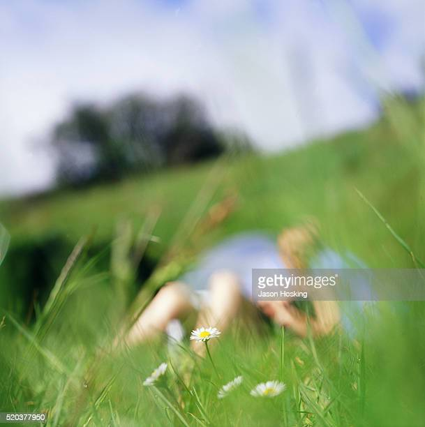 Young woman relaxing on a meadow, North Island, New Zealand