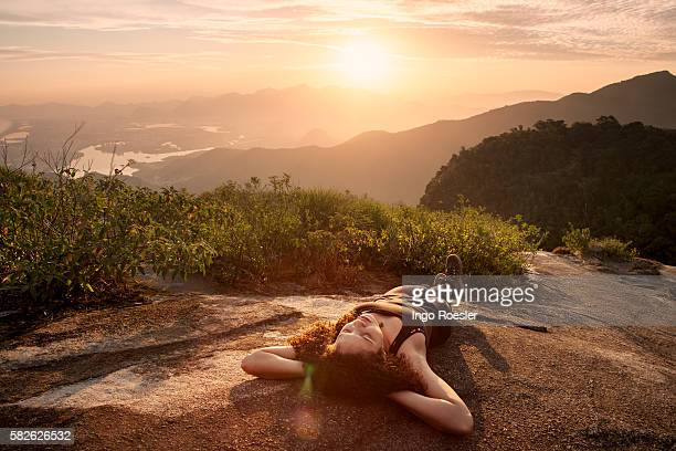 Young woman relaxing on mountain top