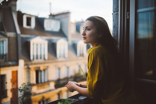 Young woman relaxing on the balcony of her Montmartre apartment - gettyimageskorea