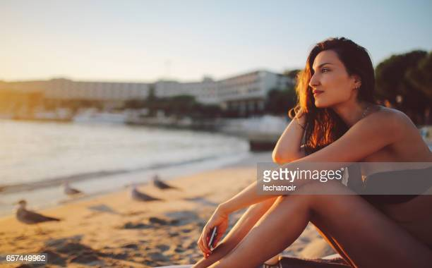 young woman relaxing on the beach in rovinj - bikini top stock pictures, royalty-free photos & images