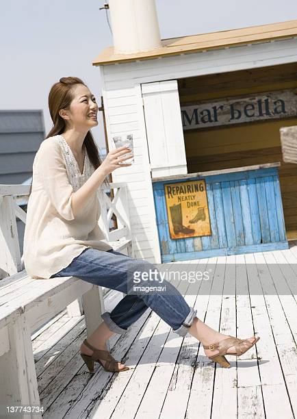 Young woman relaxing on wood deck