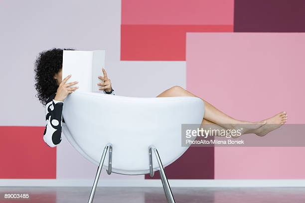 Young woman relaxing with book