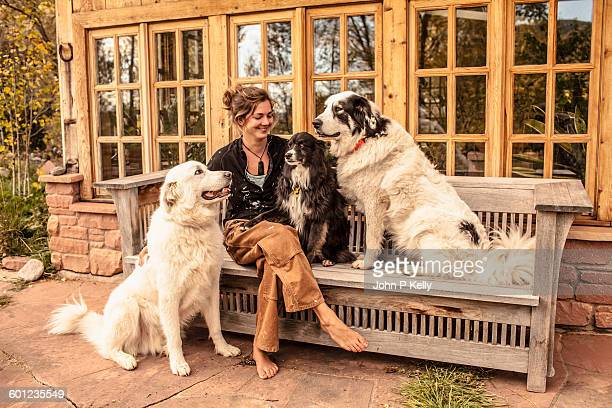 Young woman relaxing with her dogs