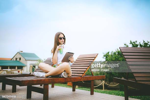 young woman relaxing with tablet