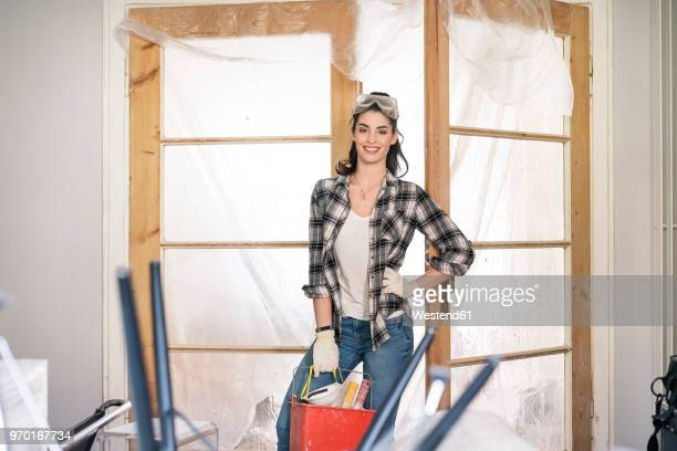 Young woman renovating her new flat