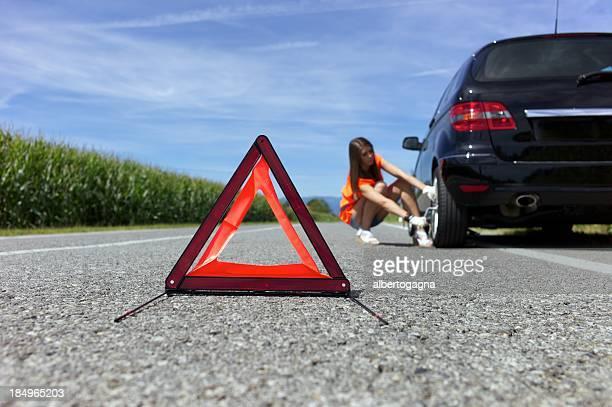 young woman repairing car