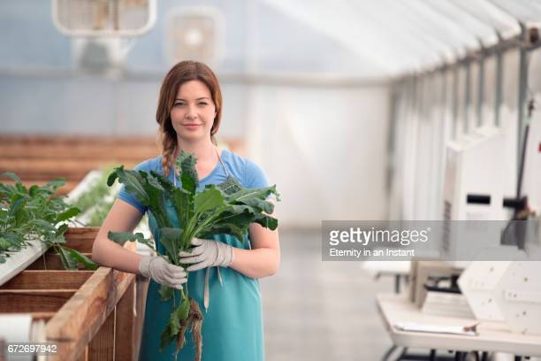Young woman researching plants in a biology lab