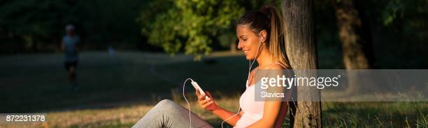 Young woman resting after exercising in summer nature