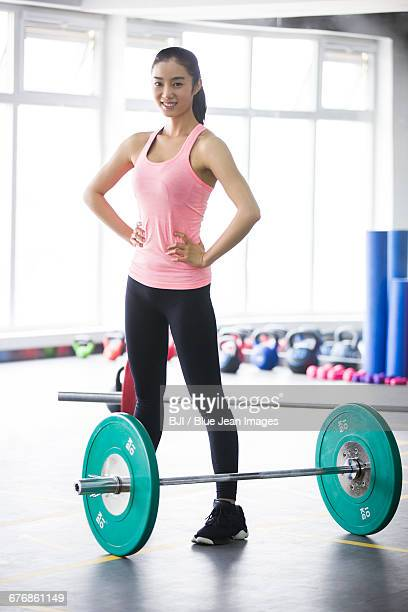 young woman resting at gym - arms akimbo stock pictures, royalty-free photos & images