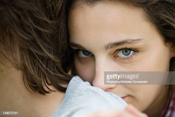 young woman resting head on boyfriend's shoulder, cropped portrait - desire stock pictures, royalty-free photos & images