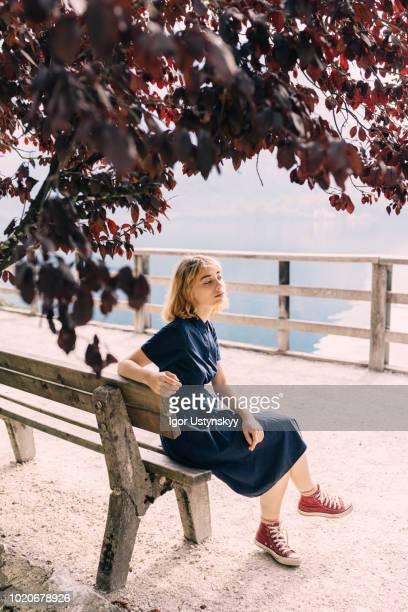 young woman resting in hallstatt - hallstatt stock-fotos und bilder