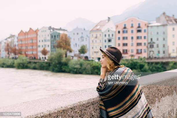 young woman resting in innsbruck - innsbruck stock pictures, royalty-free photos & images