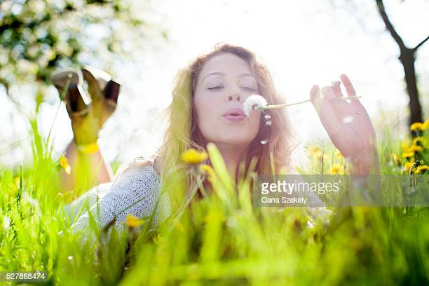 Young woman resting in meadow