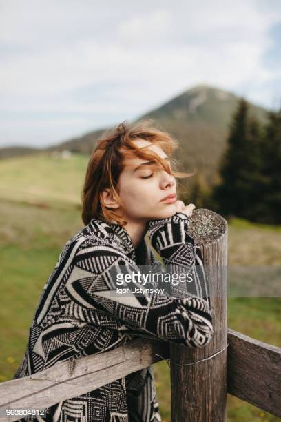 Young woman resting in mountains