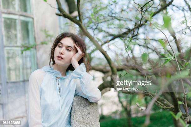 Young woman resting in public park