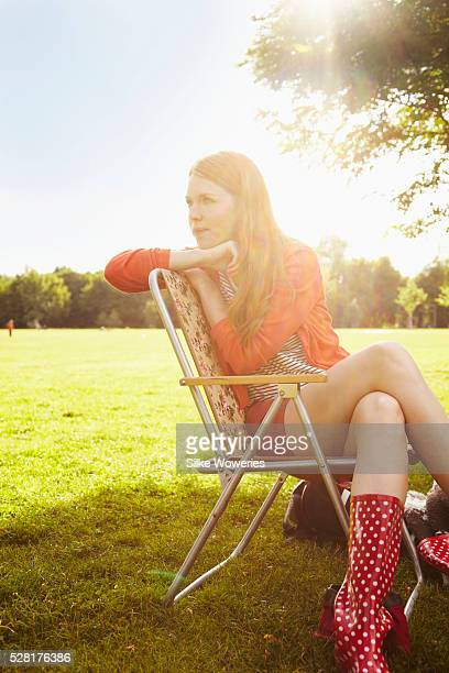 Young woman resting on camping chair