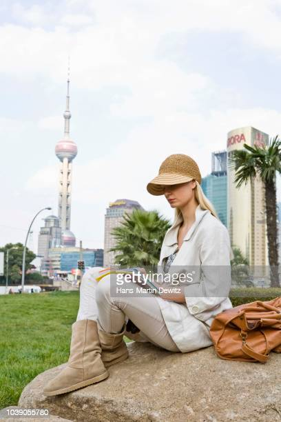 Young woman resting, Shanghai, China
