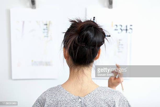 Young woman reviewing design mockups