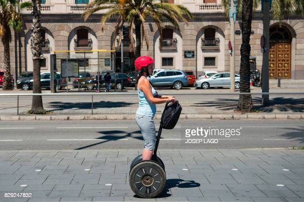 Young woman rides a segway scooter in Barcelona on August 10, 2017.