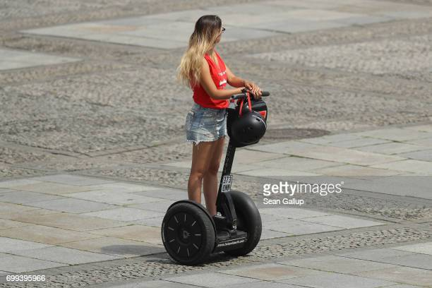 Young woman rides on a Segway on June 20, 2017 in Berlin, Germany. Segways have become increasingly popular in big cities, particularly for tourists.