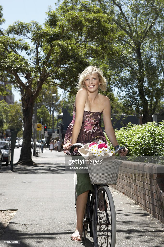 Young Woman Riding a Bicycle on a Pavement : Stock Photo