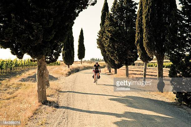 Young Woman Riding a Bike in the Countryside of Tuscany