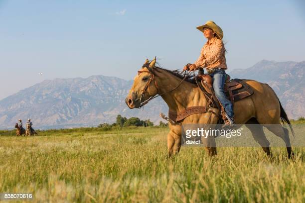 young woman riding a horse across the prairie - recreational horseback riding stock pictures, royalty-free photos & images