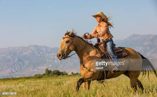 young woman riding a horse across the prairie - horseback riding stock pictures, royalty-free photos & images