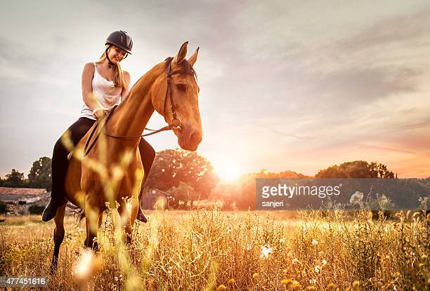 young woman riding a horse in nature - horse stock pictures, royalty-free photos & images