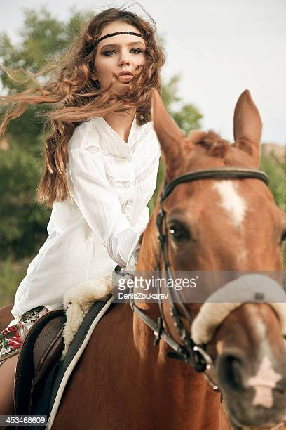 young woman riding a horse - cowgirl hairstyles stock photos and pictures