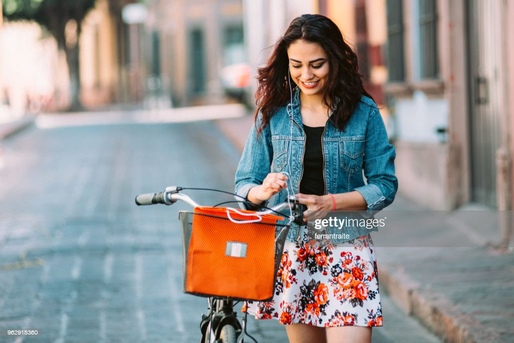 Young woman Riding Bicycle in Mexico : Stock Photo