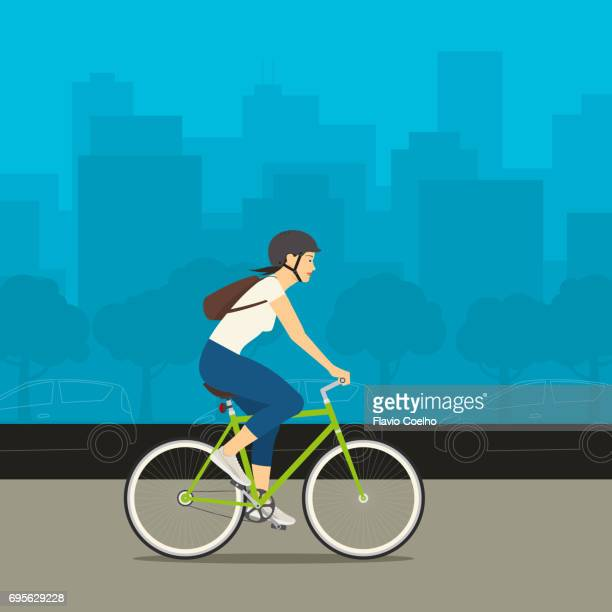 Young woman riding her bike with a big city and cars on the background stock illustration