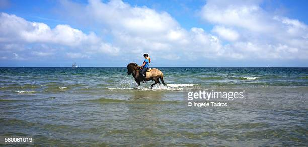 Young woman riding her house in the sea