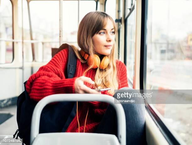 young woman riding in public transportation - ventenne foto e immagini stock