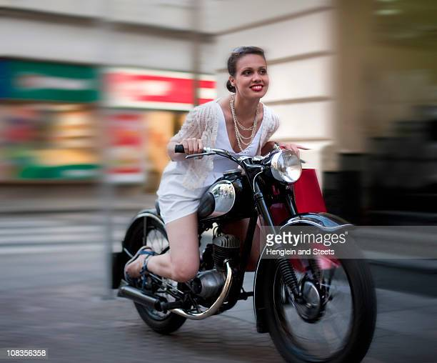 young woman riding motorcycle - exhilaration stock photos and pictures