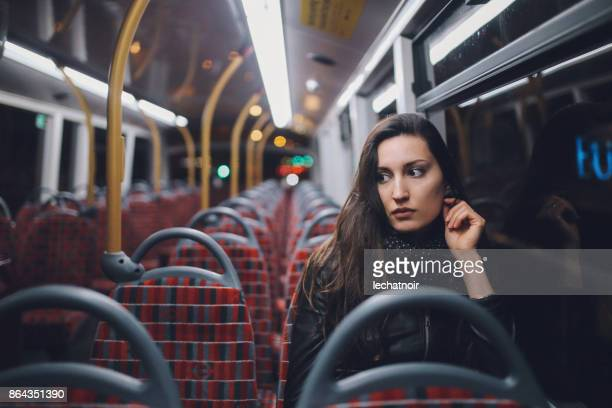 young woman riding on a late bus in london - uncomfortable stock pictures, royalty-free photos & images