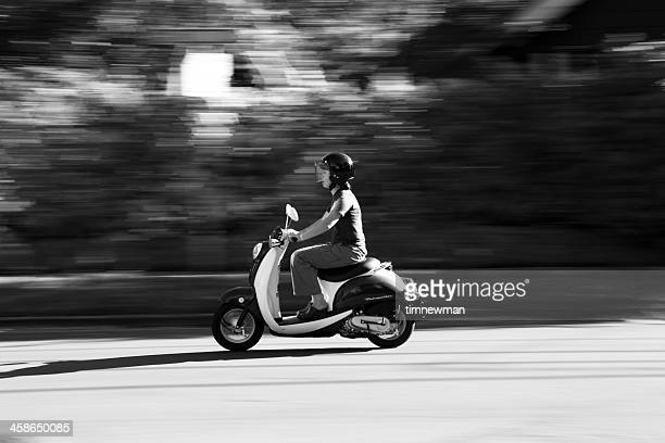 young woman riding scooter in portland oregon - moped stock photos and pictures