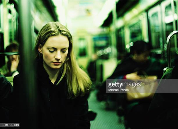 Young Woman Riding Subway