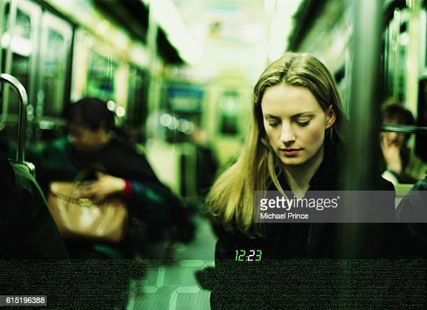 Young Woman Riding Subway