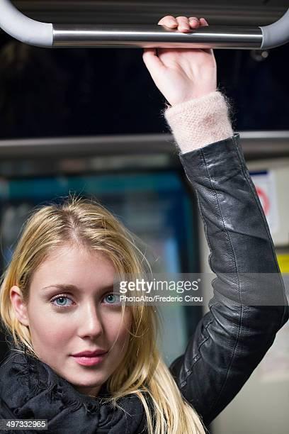 Young woman riding subway, portrait