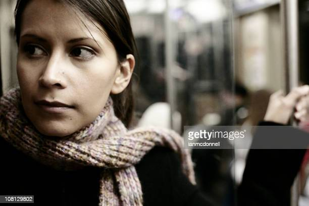 Young woman riding the subway back home