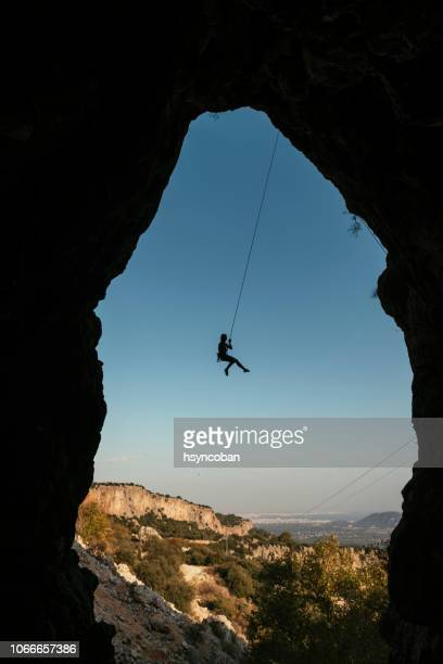 young woman rock climber - rock wall stock pictures, royalty-free photos & images