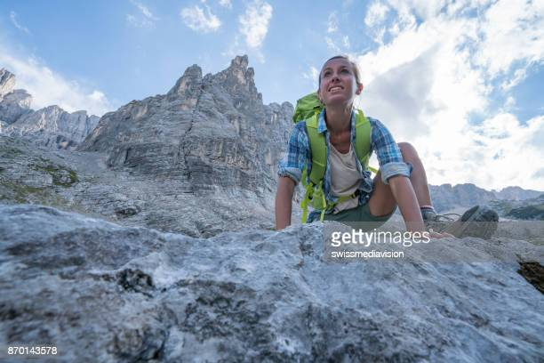 Young woman rock climbing in Italy