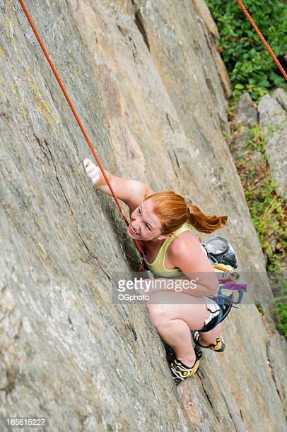 young woman rock climbing - ogphoto stock photos and pictures