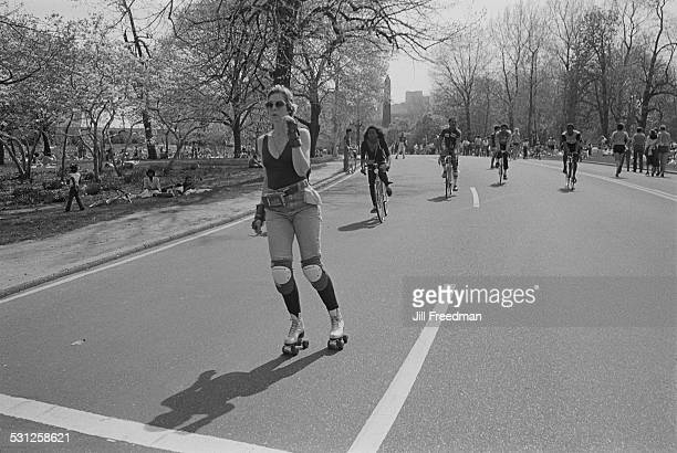 A young woman rollerskating through Central Park New York City circa 1976