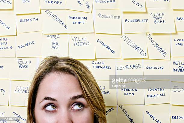 Young woman rolls her eyes at mass of business buzzwords