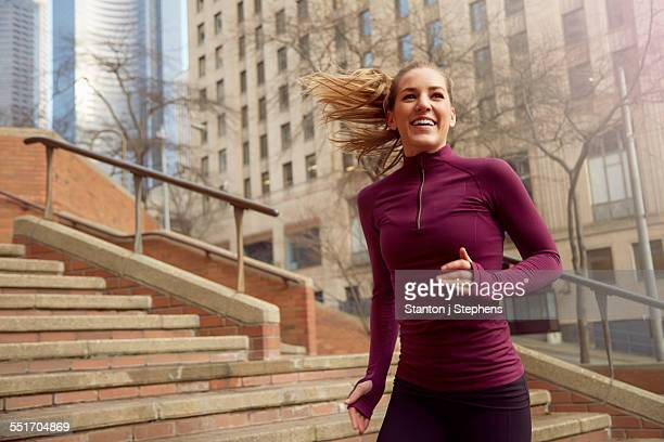 Young woman running along street, Pioneer Square, Seattle, USA