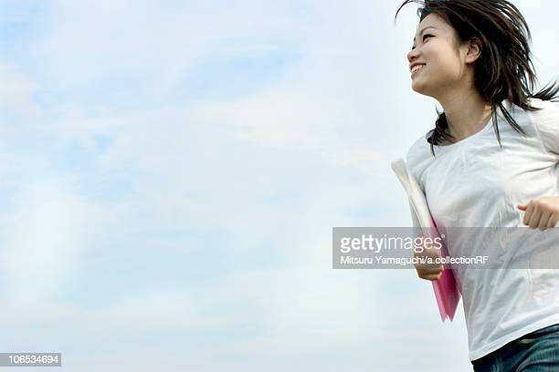 Young woman running and smiling