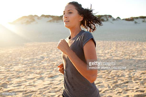 Young woman running at sunset on Australian beach