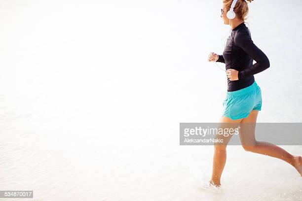 Young woman running at the beach